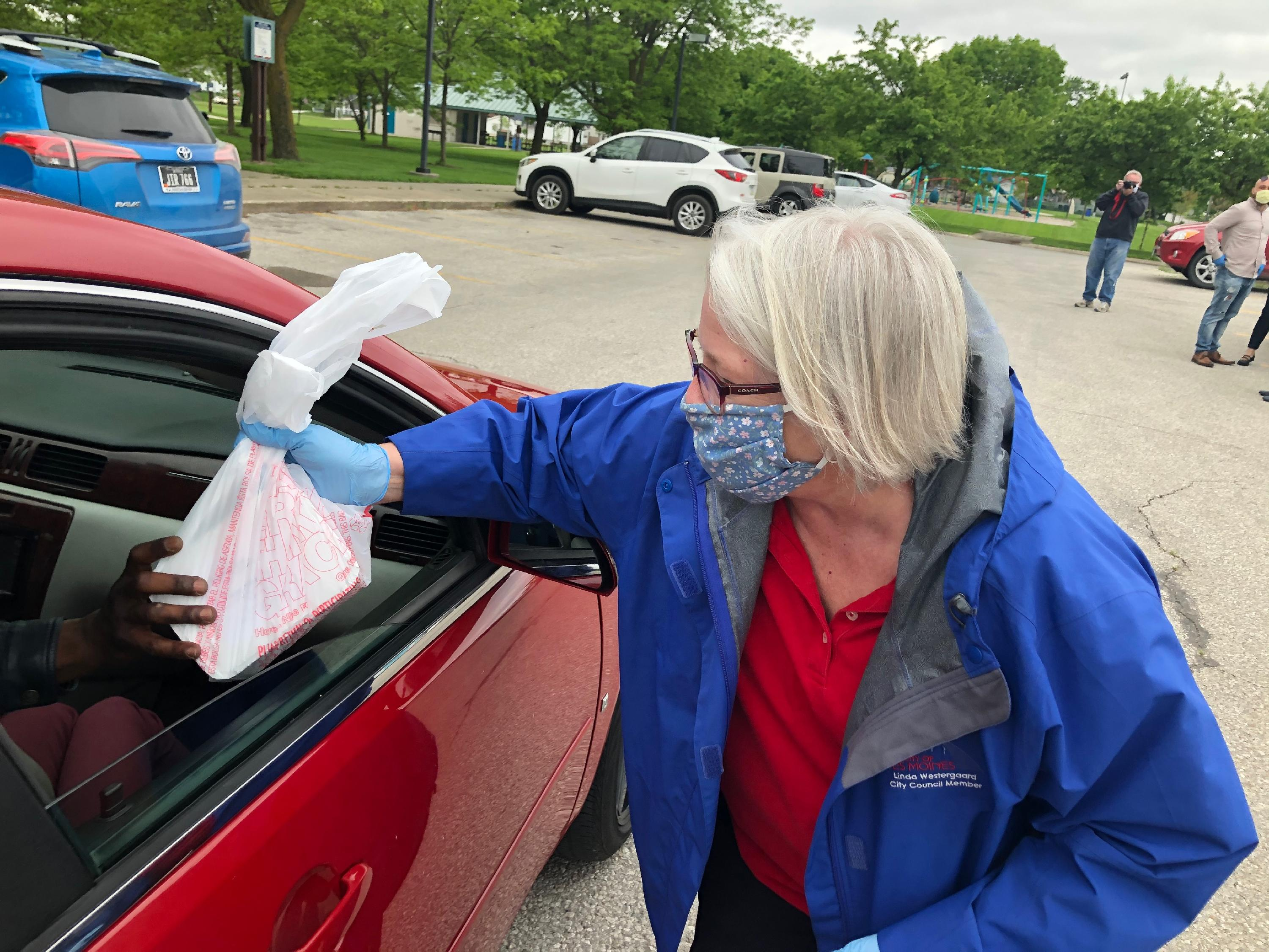 City Councilwoman Linda Westergaard distributing free meals
